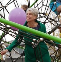 Paula Southgate joins in at playground opening.